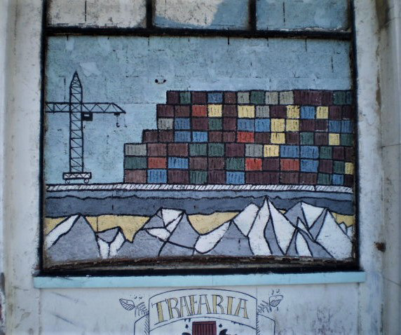 Street art on walled window.