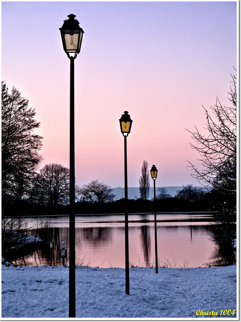 Street light into winter twilight