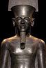 Statue en diorite du dieu Amon protégeant Toutânkhamon