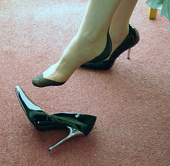Paul's wife has dropped her high heeled shoe.....