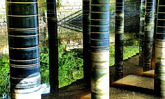 Pillars and Reflections Under The Bridge