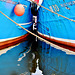 Two reflected blue boats