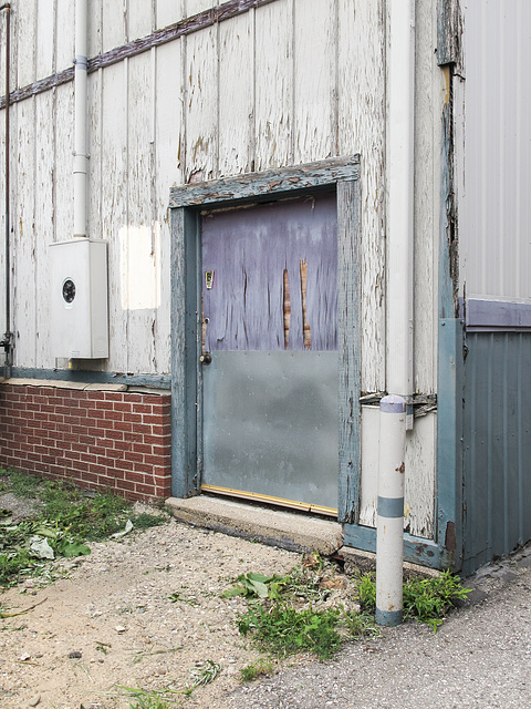 Wide half-purple door.