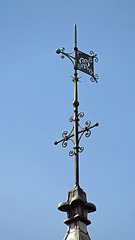 Atop the towers, wind vane 1