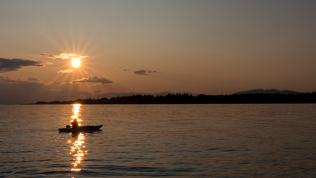 Kayaker in Sunset Beam