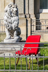 The lion and the red chair