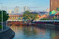 Singapore river with Clarke Quay and tourist boats in the morning