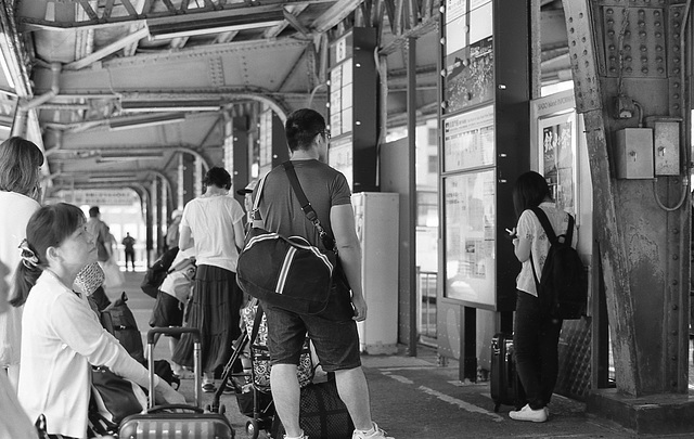 Holiday tourists at the bus terminal