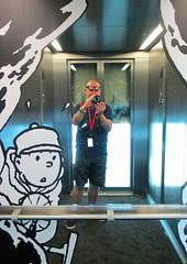 Self portrait in a lift, Musee Herge.