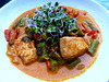 Salmon with asparagus, bell peppers, tomatoes and self-grown sprouts
