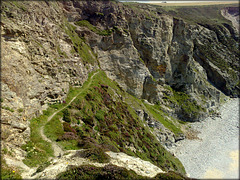 Blue rope. Path to the beach at high tide. Porthtowan, Cornwall
