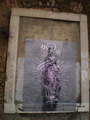 Poster on walled door.