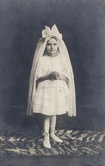 Dwarfed By Her Veil