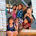 Kids playing in a corrugated-iron hut