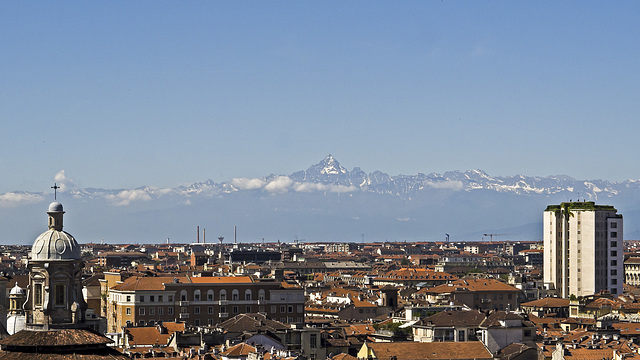 Turin from the top of the bell tower of the St. John Baptist Cathedral - View on the roofs, until the Monviso, by the impression who stands up over the city