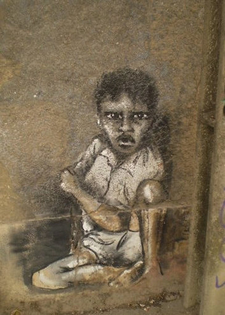 Kid on the wall of abandoned building, by Rosarlette.