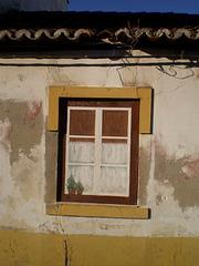 Trompe l'eil on walled window.