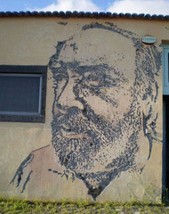 Portrait carved by Vhils.