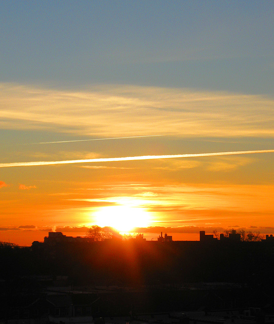 Sunrise With Contrails