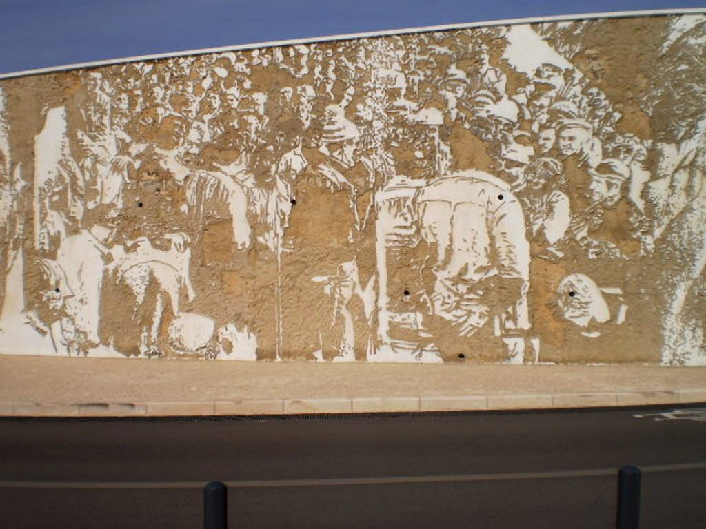 Mural by Vhils - workers of chemical industry.