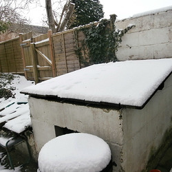 "The coal bunker had at least 3"" of snow on its top"