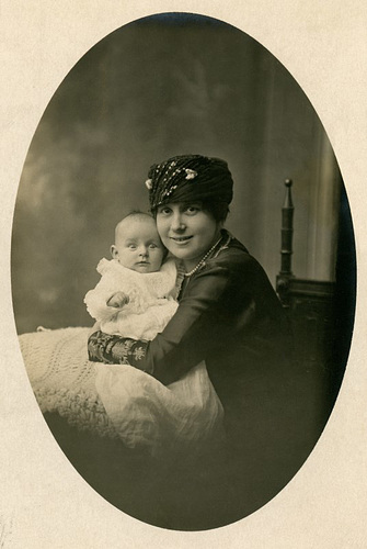 Smiling Mother with Wide-Eyed Baby (Full Version)