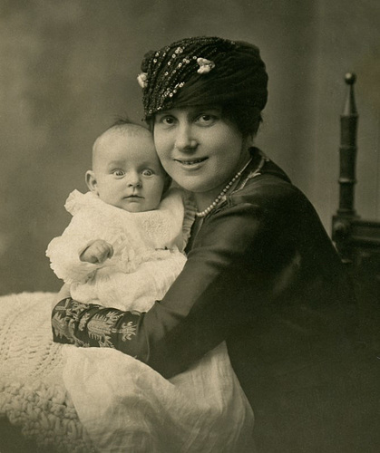 Smiling Mother with Wide-Eyed Baby