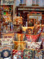 tapestry window display + photographer reflection