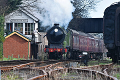 The fireman takes the single line token from the signalman at Sheringham West