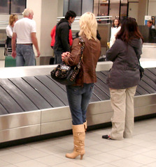 Blonde mature in pale leather high-heeled Boots back from Spain