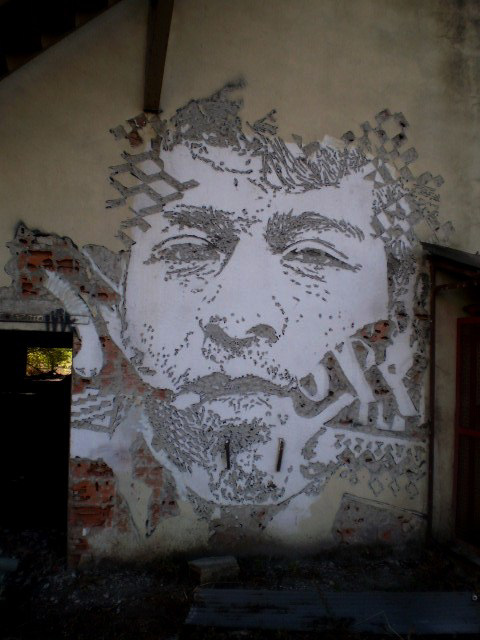 Mural carved by Vhils.