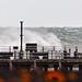 Beyond the Pleasure Pier, stormy seas pound the Stone Pier