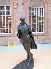 Philip Larkin in bronze at Hull Paragon Station.