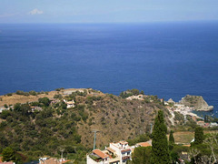 Towering view over Mazzarò and the Ionian Sea.
