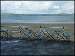 windblown deckchairs