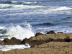 Watching the waves break over the rocks