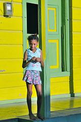 In front of an housedoor in the lane of Baracoa