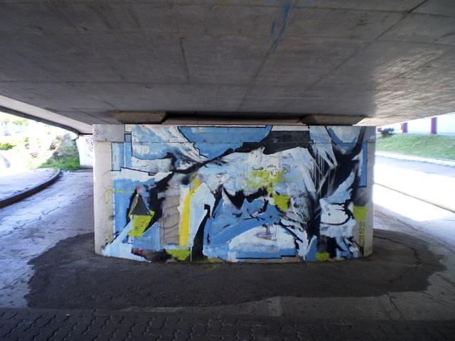 Graffiti on pillar of viaduct.
