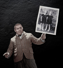 Curley With a Photo of the Reinhoffer Twins