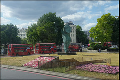 buses round a statue