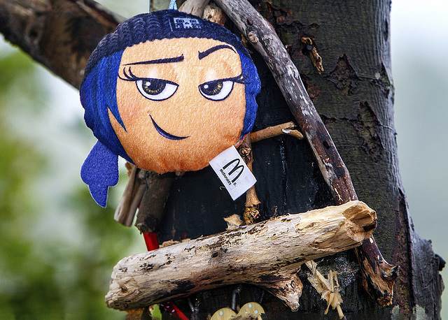 Wee Doll up a Tree in the Pouring Rain