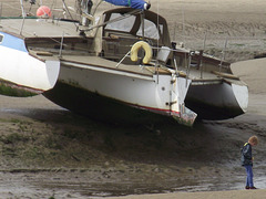 This trimarin beached with the tide out - but it's mostly not supported!!!!