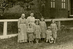 Women and Kids in Front of a House (Cropped)