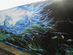 Mural by Peguinho Arte.