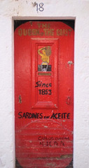 Sardines can painted on door.