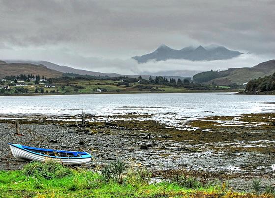 A glimpse of the Black Cuillin over Loch Portree, Isle of Skye