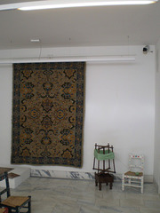 Tapestry and wool winder.