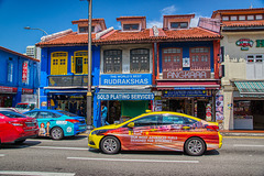 Colorful shop houses and taxis in Little India district of Singapore