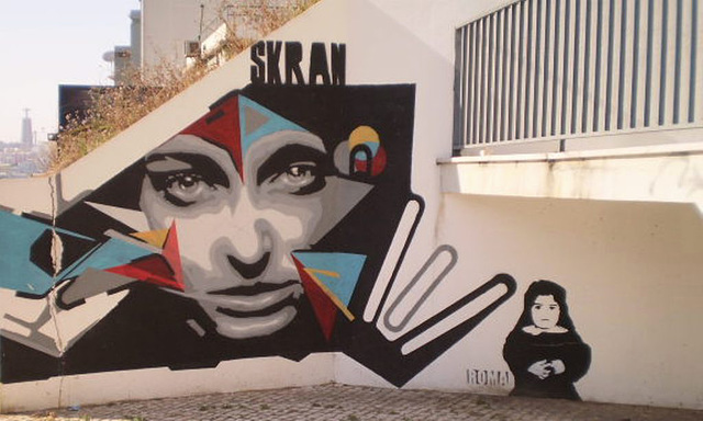 A face on the wall, by Skran.