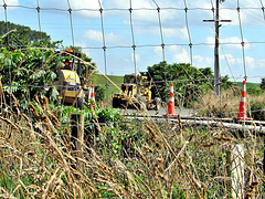Road Works Through Fence